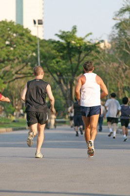 782965-two-men-running-together-in-a-park-popular-for-jogging